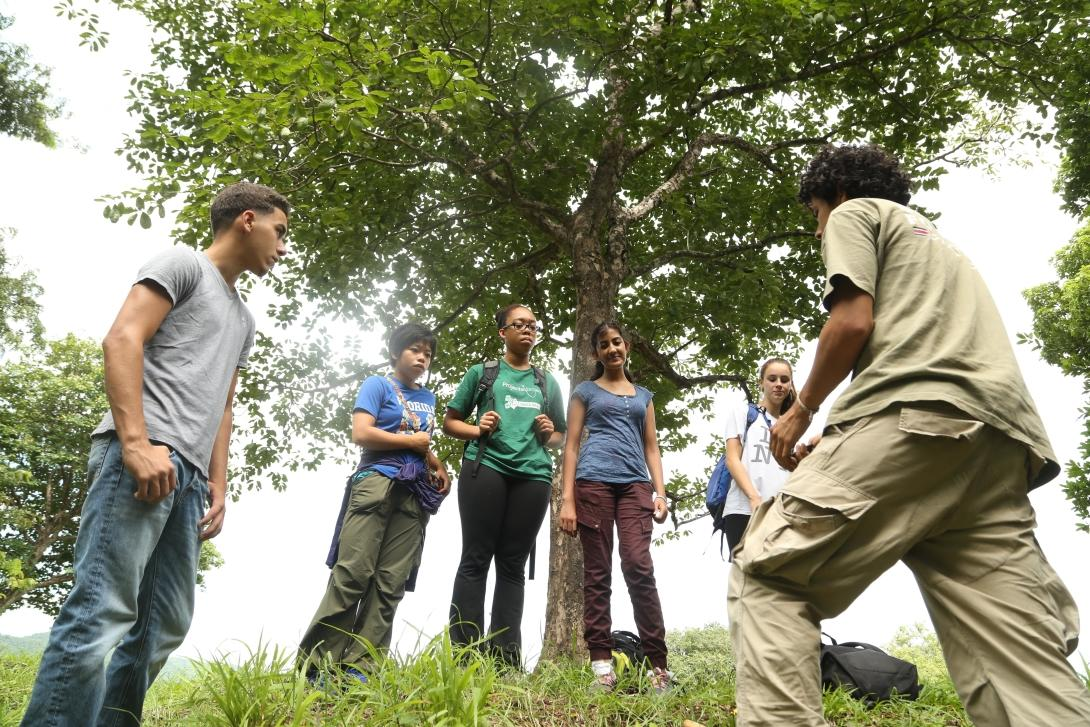 A staff member talks to Conservation volunteers about reforestation in Costa Rica
